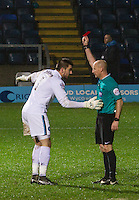 Goalkeeper Matt Ingram of Wycombe Wanderers is shown red for a foul by referee A Davies during the Sky Bet League 2 match between Wycombe Wanderers and Morecambe at Adams Park, High Wycombe, England on 2 January 2016. Photo by Kevin Prescod / PRiME Media Images