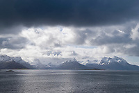 Cloudy skies and snowy mountains along Norwegain coast