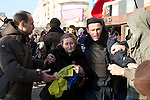 Mcc0053565 . Daily Telegraph<br /> <br /> An old woman clutching the Ukrainian flag is escorted to safety by a single policeman whilst be chased away and violently intimidated by pro Russian supporters. <br /> A planned pro Ukraine rally was cancelled as pro Russia supporters violently intimidated those brave enough to voice their support for the new western leaning Kiev government .<br /> <br /> Donetsk 9 March 2014