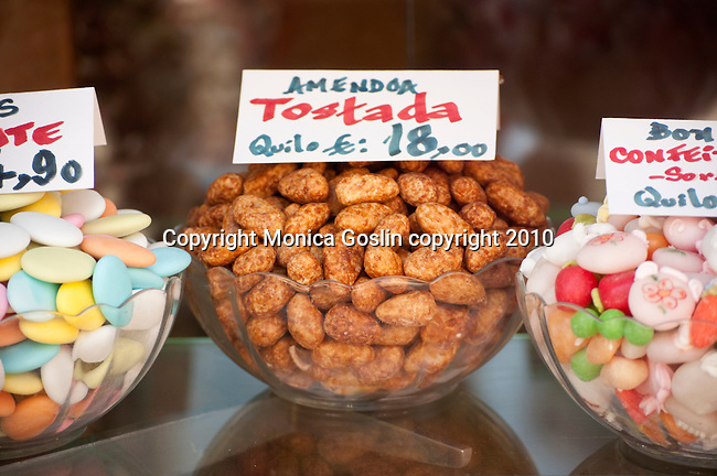 Nuts and candy in a shop window in Porto, Portugal.