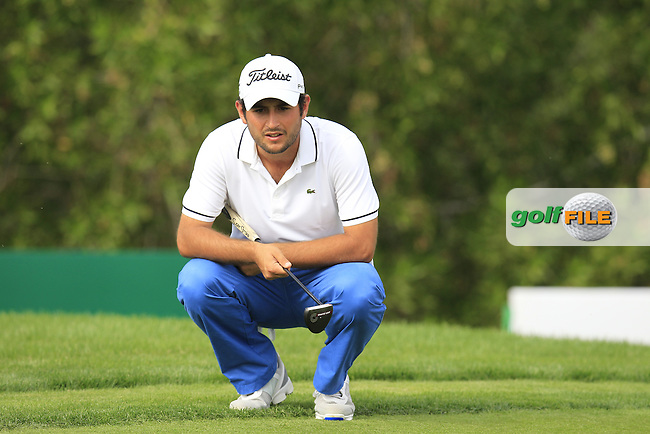 Alexander Levy (FRA) lines up his putt on the 10th green during Sunday's Final Round of the Abu Dhabi HSBC Golf Championship 2015 held at the Abu Dhabi Golf Course, United Arab Emirates. 18th January 2015.<br /> Picture: Eoin Clarke www.golffile.ie