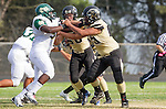 Palos Verdes, CA 10/25/13 - Khalil Sonko (Mira Costa #51) and Jeric Lagmay (Peninsula #65) in action during the Mira Costa vs Peninsula varsity football game at Palos Verdes Peninsula High School.