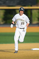 Matt Conway (25) of the Wake Forest Demon Deacons rounds second base after hitting a home run against the Maryland Terrapins at Wake Forest Baseball Park on April 4, 2014 in Winston-Salem, North Carolina.  The Demon Deacons defeated the Terrapins 6-4.  (Brian Westerholt/Four Seam Images)