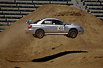 A rally car gets some air while competing in the Rally Car Race finals during X-Games 12 in Los Angeles, California on August 5, 2006.