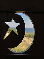Star and Moon Cut Outs in Thalassa's Cape Code Dune Shack Privy