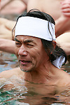 A participant dressed only in loincloth prays in a pool of freezing-cold water containing two large blocks of ice during the 62nd Annual Cold-Endurance Festival, Kanchu-Misogi, at Teppozu Inari Shrine on January 8, 2017, Tokyo, Japan. About 100 brave participants joined the purification ritual to pray for a healthy new year. (Photo by Rodrigo Reyes Marin/AFLO)