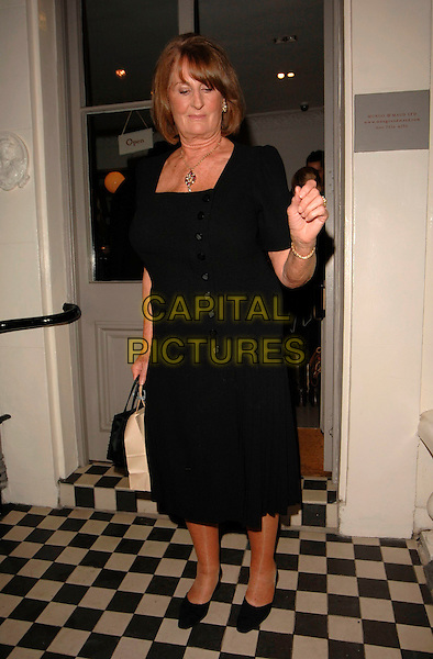 "LADY ANNABEL GOLDSMITH.Lady Annabel Goldsmith's Book Signing for her latest title ""Copper: A Dog's Life"", Mungo & Maud Store, Belgravia, London, England, February 20th 2007..full length black dress hand.CAP/CAN.©Can Nguyen/Capital Pictures"