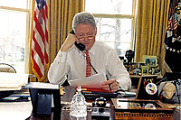 ***FILE PHOTO*** Bill Clinton Has Not Apologized To Monica Lewinsky And Claims Did The Right Thing Staying In Office.<br /> <br /> United States President Bill Clinton speaks on the telephone to President Boris Yeltsin of Russia from the Oval Office of the White House in Washington, DC on February 27, 1997.<br /> CAP/MPI/RS<br /> &copy;RS/MPI/Capital Pictures