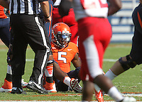 Virginia quarterback David Watford (5) is sacked on a play during the football game Saturday Oct. 5, 2013 at Scott Stadium in Charlottesville, VA. Ball State defeated Virginia 48-27. Photo/The Daily Progress/Andrew Shurtleff