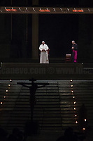 """Dedicated to Prof. Enrico P. Grazie Amico mio di essere una roccia e Grazie di essere rimasto qui con Noi!<br /> <br /> Rome, 10/04/2020. On the evening of the Good Friday, Papa Francesco (Pope Francis, Jorge Mario Bergoglio) celebrated the Via Crucis (Way to the Cross: the final moments of the Passion, death and burial of Jesus Christ) in a spectral Saint Peter's Square where the path of the Cross was marked with burning torches located around the obelisk. These year, the traditional Via Crucis could not be held at the Colosseum, people were not allowed to attend it, and member of the press were kept really far from the event due to the spread of the Coronavirus (SARS-CoV-2 - infection: COVID-19) which already killed more than 100,000 people globally.      <br /> «[…] For 2020, the meditations for the fourteen """"Stations"""" along the Way of the Cross were prepared by the chaplaincy of the Due Palazzi House of Detention in the northern Italian city of Padua. Five prisoners, the family of a murder victim, the daughter of a man given a life sentence, the mother of another prisoner, a guard, and a priest who was convicted of a crime but eventually exonerated, were among those contributing their reflections on the Passion of the Lord, and how it bears on their own situations. […] With the path marked out by burning torches on the ground, the black Cross was carried around the obelisk at the centre of the Square, before coming to the door of the Basilica. The Cross was escorted by members of the Due Palazzi chaplaincy, and by members of the Health and Hygiene Directorate of the Vatican City State. […]» (1.).<br /> <br /> Footnotes & Links:<br /> 1. https://www.vaticannews.va/en/pope/news/2020-04/pope-francis-leads-good-friday-via-crucis-at-st-peter-basilica.html<br /> Video of the event (Source, Vaticannews.va) https://youtu.be/nxUTl7yBt7E"""