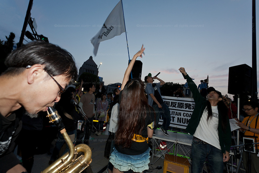 Anti nuclear protesters play music and dance at the end of a protest to mark No Nuke Day outside the national Diet Building in Kasumigaseki  . Tokyo, Japan Sunday June 2nd 2013