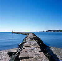 A jetty extends from the edge of the property into Long Island Sound
