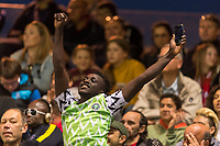 REIMS, FRANCE - JUNE 08: A Nigeria Fan celebrates in the stands during a game between Norway and Nigeria at Stade Auguste-Delaune on June 8, 2019 in Reims, France.