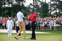 Tiger Woods (USA) celebrates with Tony Finau (USA) after sinking his putt to win The 2019 Masters , Augusta National, Augusta, Georgia, USA. 14/04/2019.<br /> Picture Fran Caffrey / Golffile.ie<br /> <br /> All photo usage must carry mandatory copyright credit (© Golffile | Fran Caffrey)