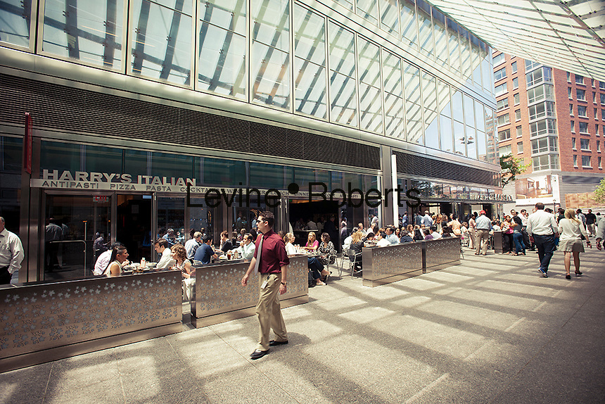 Office workers and residents take advantage of the warm seasonal weather as they walk on North End Way, connecting Vesey and Murray Streets, just west of West Street, seen in Lower Manhattan in New York on Friday, June 15, 2012.  Nestled between the Goldman Sachs building and the Conrad New York Hotel the alley is filled with restaurants, including the Shake Shack, and other food establishments making it a destination in its own right. (© Richard B. Levine)