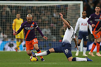 Harry Kane of Tottenham Hotspur stretches for a ball against David Silva of Manchester City during Tottenham Hotspur vs Manchester City, Premier League Football at Wembley Stadium on 29th October 2018