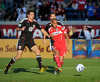 Chicago Fire forward Calen Carr (3) shoots the ball in front of DC United defender Dejan Jakovic (5).  The Chicago Fire tied DC United 0-0 at Toyota Park in Bridgeview, IL on Oct. 16, 2010.