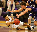 SIOUX FALLS, SD - DECEMBER 31: Jordan Spencer #23 from Augustana University passes the ball from the ground away from Drew Maschoff #15 from the University of Sioux Falls during their game Sunday afternoon December 31, 2017 at the Stewart Center in Sioux Falls, SD.  (Photo by Dave Eggen/Inertia)