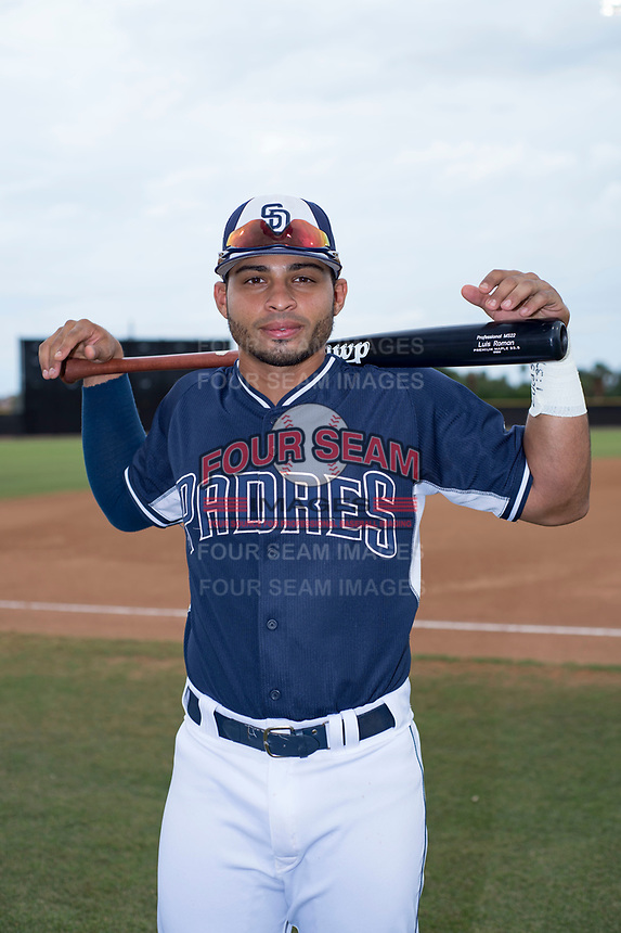 San Diego Padres 2 utility player Luis Roman (4) poses for a photo before an Arizona League game against the AZL Padres 1 at Peoria Sports Complex on July 14, 2018 in Peoria, Arizona. The AZL Padres 1 defeated the AZL Padres 2 4-0. (Zachary Lucy/Four Seam Images)