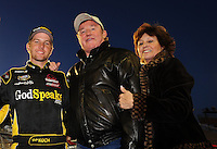 Apr 16, 2009; Avondale, AZ, USA; NASCAR Camping World Series West driver Blake Koch (left) with car owner Richard Childress (center) and wife Judy Childress prior to the Jimmie Johnson Foundation 150 at Phoenix International Raceway. Mandatory Credit: Mark J. Rebilas-