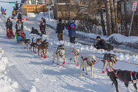 Emily Maxwell on Cordova St. hill during the Anchorage start day of Iditarod 2018 on Cordova St. hill during the Anchorage start day of Iditarod 2019