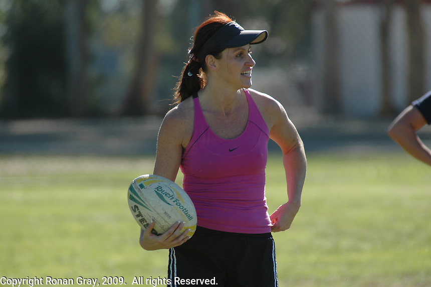"""Saturday, 01/17/09:  San Diego, California, USA:  Ruth Oram smiles after scoring a try during a game of touch rugby at Torrey Highlands Park in Del Mar.  An informal group of players organised by Oram meets every Saturday morning at 11am for games.  The sport of Touch Rugby is a fast paced, exciting version of the full contact game that is gaining popularity in San Diego.  As the name suggests, the """"touch"""" version of it is not a full contact game but more like flag football.  Pick-up games can be found most Saturdays in the Del Mar Park and on Sundays at the beach in Del Mar or Mission Beach."""
