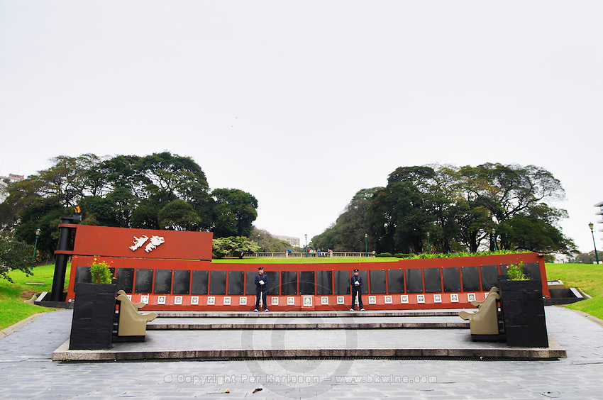 Monument commemorating the Falkland war Islas Malvinas on the Plaza San Martin Square, black marble plaques with names engraved of the soldiers in the war on red stone background, map of the island, two military honour guards in a park. the Plaza San Martin Square renamed Plaza de la Fuerza Aerea or Plaza Fuerza Retiro Buenos Aires Argentina, South America