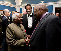 Archbishop Desmond Tutu is welcomed by US Representative James Clyburn during a reception  at the US Capitol prior to the US Soccer Foundation Gala held at City Center in Washington, DC.