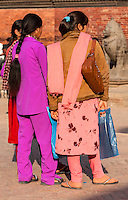 Nepal, Patan.  Nepalese Women in Durbar Square  Wearing Contemporary Modern Clothing.