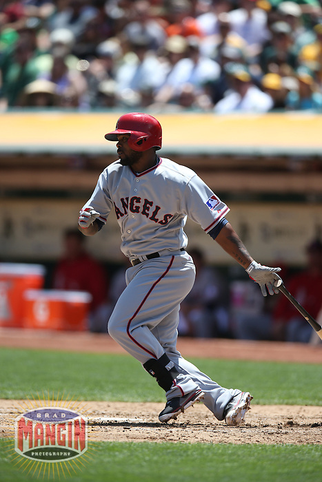 OAKLAND, CA - JULY 27:  Howie Kendrick #47 of the Los Angeles Angels bats against the Oakland Athletics during the game at O.co Coliseum on 1969 Turn Back the Clock Day on Saturday, July 27, 2013 in Oakland, California. Photo by Brad Mangin