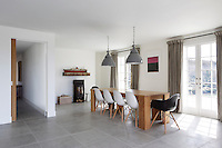 The majority of the internal walls of the property as well as the staircases were removed to create an open plan kitchen and dining area