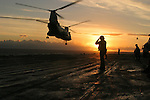 As the ships of the 3rd Expeditionary Strike Group arrive off the coast of Oahu, Hawaii the last of a trio of CH-46E Sea Knight helicopters, carrying portions of Charlie Co. 1/4 Marines, rises from the deck of the USS Belleau-Wood en route to Hawaii's Schofield Army Barracks where it will deliver its passengers for two days of training in the field.