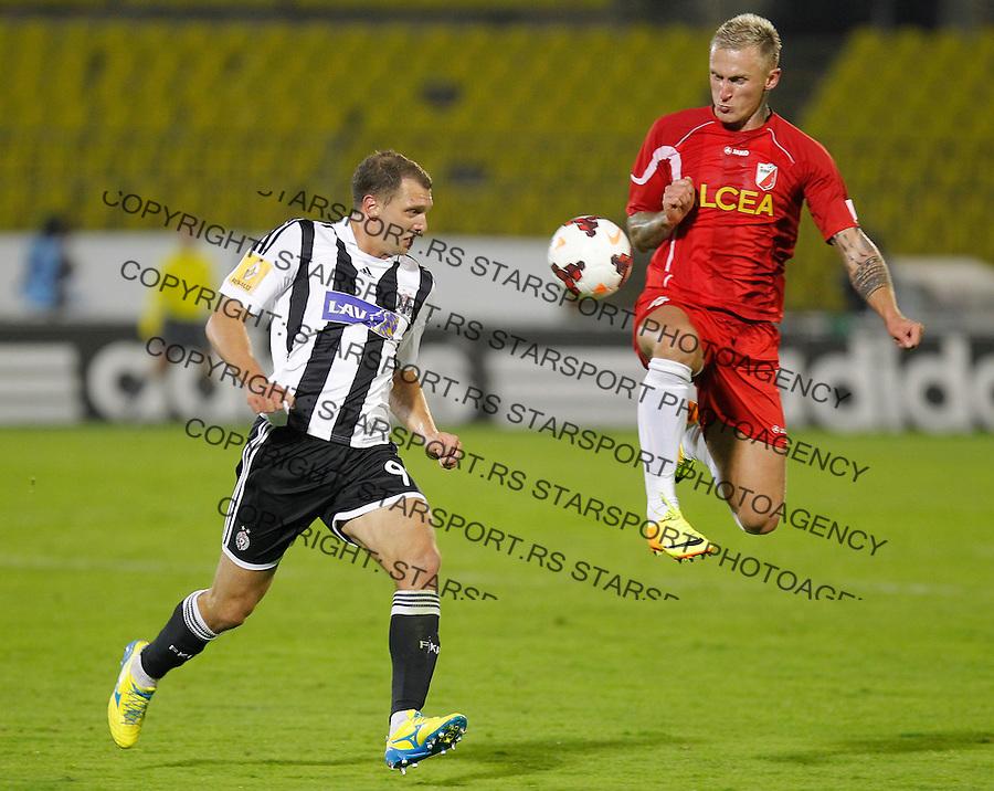 Fudbal Super liga season 2013-2014<br /> Partizan v Javor (Ivanjica)<br /> Nemanja Kojic (L) and Zeljko Djokic<br /> Beograd, 05.10.2013.<br /> foto: Srdjan Stevanovic/Starsportphoto &copy;