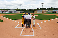 Lineup exchange with manager Dave Berg (left), umpires Adam Beck, J.J. January, James Rackley and coach Michael Johnson (right) before the 20th Annual Rickwood Classic Game against the Jacksonville Suns on May 27, 2015 at Rickwood Field in Birmingham, Alabama.  Jacksonville defeated Birmingham by the score of 8-2 at the countries oldest ballpark, Rickwood opened in 1910 and has been most notably the home of the Birmingham Barons of the Southern League and Birmingham Black Barons of the Negro League.  (Mike Janes/Four Seam Images)