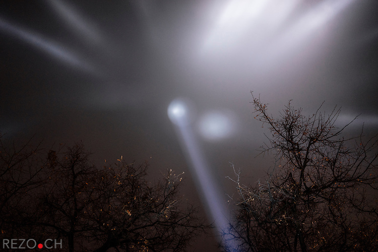 February 20, 2015. Kiev, Ukraine. Commemoration of the Heavenly Hundred (name given to the civilians killed by the police during the Euromaidan protests) on Maidan. Spotlights were placed along Institutskaya street at the positions where protesters where killed. Their portraits were projected on giant screens on Maidan sqare.  Credits: Niels Ackermann / Rezo.ch
