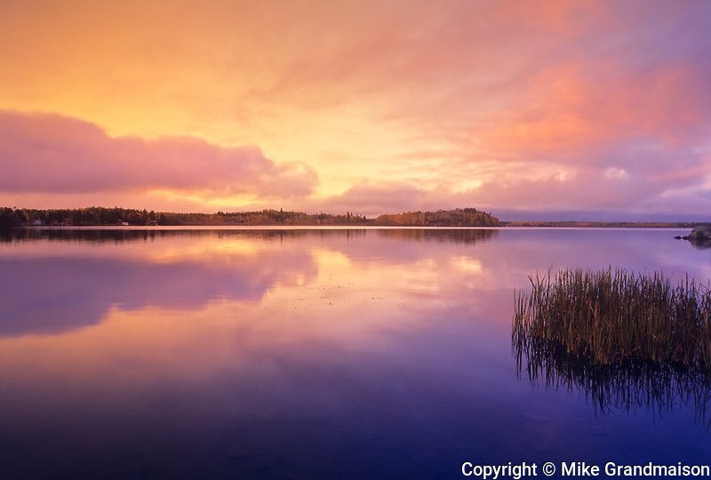 Reflection on White Lake at dawn, Whiteshell Provincial Park, Manitoba, Canada