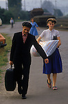 Friedland refugee camp West Germany. 1980's. Soviet-Germans return as refuges from the Soviet Union to freedom in the west. Having been processed, documents checked etc this family walks to the train station with their belongings for a journey to a new life.