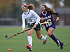 Carle Place No. 10 Alex Docyk, left, moves the ball downfield as Oyster Bay No. 16 Krista Marino closes in on her during the Nassau County varsity field hockey Class C final at Adelphi University on Sunday, November 1, 2015. Carle Place won by a score of 5-0.<br /> <br /> James Escher
