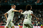 Real Madrid's Gareth Bale (L) and Marcelo Vieira (R) celebrate goal during UEFA Champions League match between Real Madrid and FC Viktoria Plzen at Santiago Bernabeu Stadium in Madrid, Spain. October 23, 2018. (ALTERPHOTOS/A. Perez Meca)