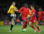 Watford's Sebastian Prodl tussles with Liverpool's Divock Origi and Philippe Coutinho during the Premier League match at Vicarage Road Stadium, London. Picture date: May 1st, 2017. Pic credit should read: David Klein/Sportimage