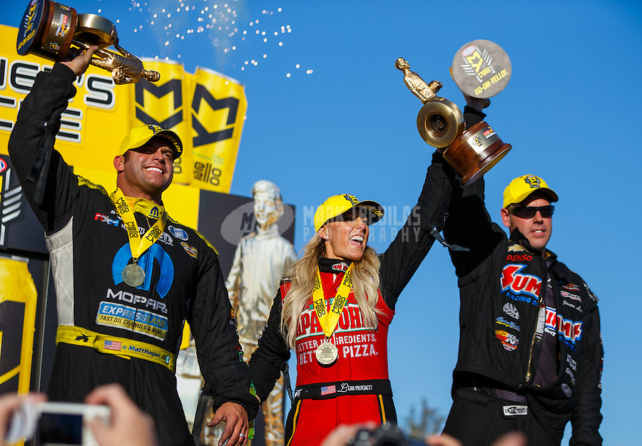Feb 12, 2017; Pomona, CA, USA; NHRA funny car driver Matt Hagan (left), top fuel driver Leah Pritchett (center) and pro stock driver Jason Line celebrate after winning the Winternationals at Auto Club Raceway at Pomona. Mandatory Credit: Mark J. Rebilas-USA TODAY Sports