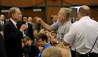 US Sen Arlen Specter, left, listens to an unidentified man, center, voice his complaints during a town hall meeting open to the public Tuesday, Aug. 11, 2009 In Lebanon, Pa. At right is a security guard. (AP Photo/Bradley C Bower)