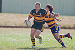 Tino Halalilo manages to arrive in time to upset Nigel Watson's clearing kick. CMRFU Counties Power Premier Club Rugby game between Patumahoe & Pukekohe played at Patumahoe on April 12th, 2008..The halftime score was 10 all with Pukekohe going on to win 23 - 18.