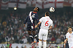 12 JUN 2010: Robbie Findley (USA) (20) and John Terry (ENG) (6). The England National Team tied the United States National Team 1-1 at Royal Bafokeng Stadium in Rustenburg, South Africa in a 2010 FIFA World Cup Group C match.