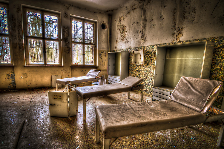 Abandoned lunatic asylum north of Berlin, Germany. Medical day beds.