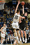 SALEM, VA - MARCH 17: Nebraska Wesleyan Prairie Wolves guard Nate Schimonitz (10) is defended by Wisconsin-Oshkosh Titans forward Adam Fravert (15) during the Division III Men's Basketball Championship held at the Salem Civic Center on March 17, 2018 in Salem, Virginia. Nebraska Wesleyen defeated Wisconsin-Oshkosh 78-72 for the national title. (Photo by Andres Alonso/NCAA Photos/NCAA Photos via Getty Images)
