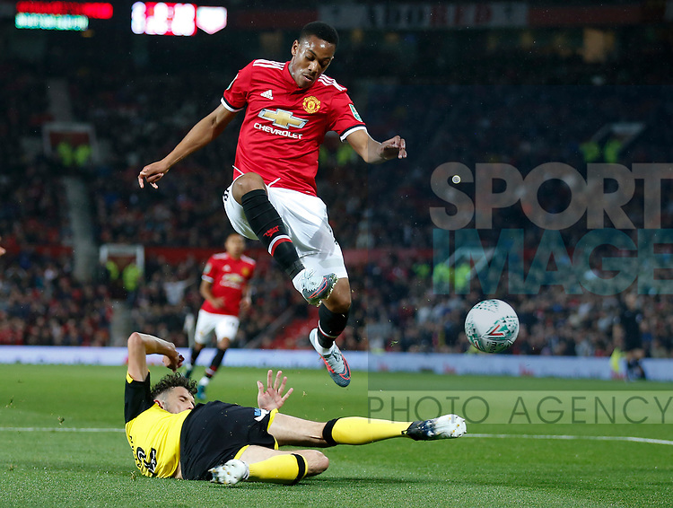 Anthony Martial of Manchester United leaps over a tackle during the Carabao Cup Third Round match at the Old Trafford Stadium, Manchester. Picture date 20th September 2017. Picture credit should read: Simon Bellis/Sportimage