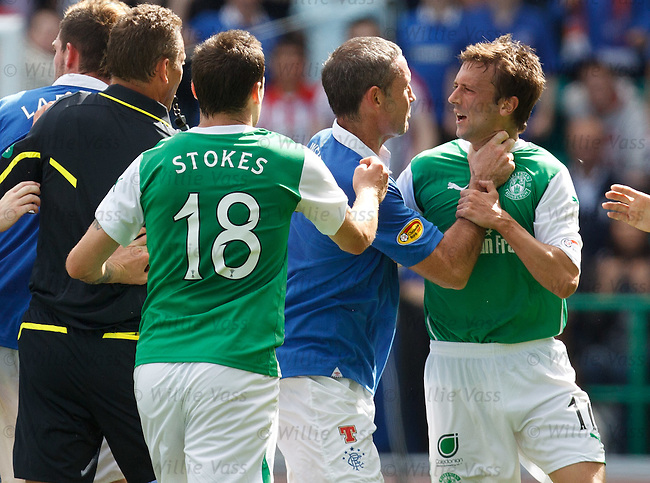 David Weir grabs Kevin McBride by the throat as referee Iain Brines pulls the shirt of Kyle Lafferty
