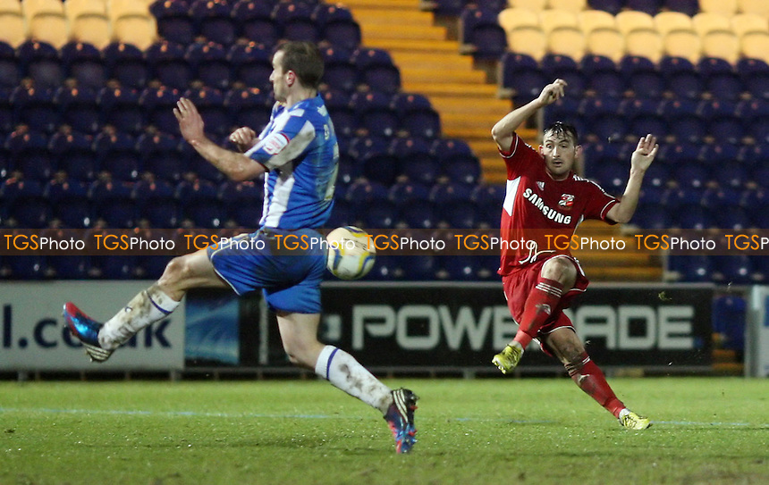 Gary Roberts of Swindon goes close with a 2nd half shot - Colchester United vs Swindon Town, nPower League One at the Weston Homes Stadium, Colchester - 05/02/13 - MANDATORY CREDIT: Rob Newell/TGSPHOTO - Self billing applies where appropriate - 0845 094 6026 - contact@tgsphoto.co.uk - NO UNPAID USE.