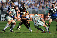 Kyle Eastmond of Bath Rugby is tackled by Geoff Parling (left) and Tom Youngs of Leicester Tigers during the Aviva Premiership match between Bath Rugby and Leicester Tigers at The Recreation Ground on Saturday 20th April 2013 (Photo by Rob Munro)